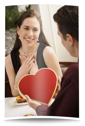 a man giving a woman a heart shaped box