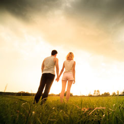 Couple Holding Hands Under A Stormy Sky